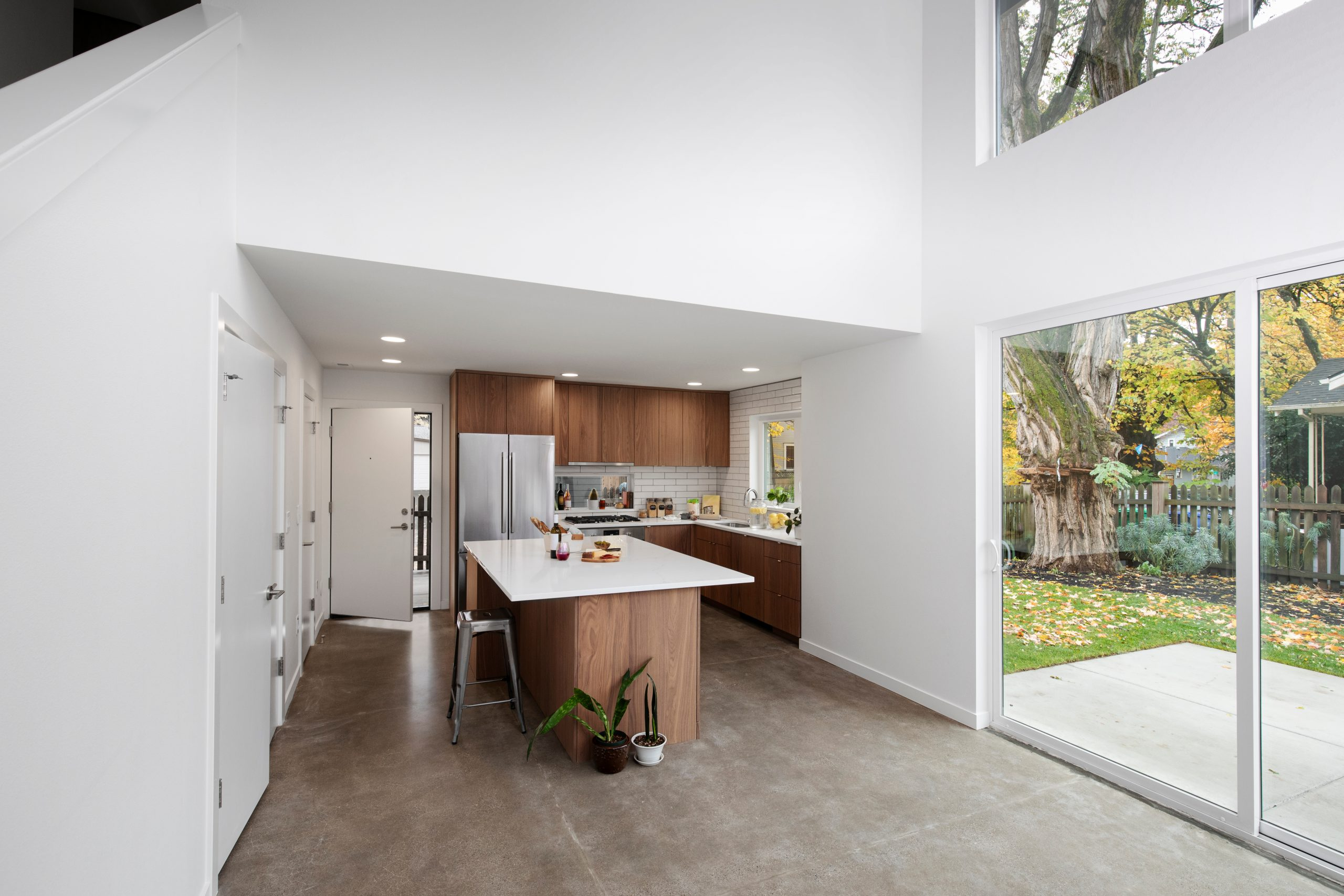 Modern,Kitchen,With,Lights,On,And,Daylight,Views.